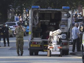 An army bomb disposal unit is parked nearby during a security operation at Springfield Street in Wigan, Greater Manchester on May 25, 2017