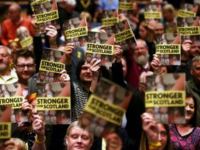 Supporters listen as Nicola Sturgeon speaks during the launch of the SNP manifesto