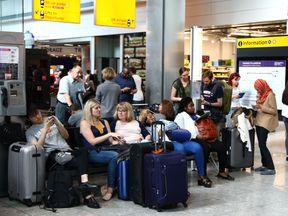 People stranded at Heathrow Terminal 5 amid a BA IT failure
