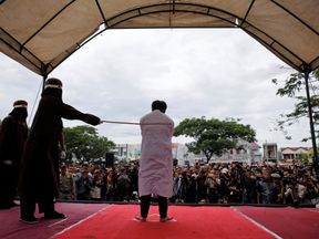 A gay man is caned in Indonesia