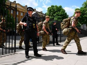 British soldiers enter a Ministry of Defence building near to New Scotland Yard