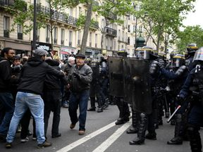 Paris police faced off with demonstrators at a trade union protest at Mr Macron's win