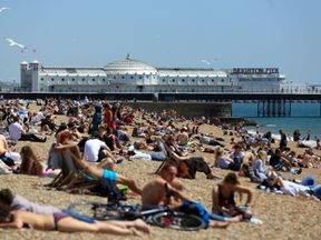 People soak up the sunshine in Brighton