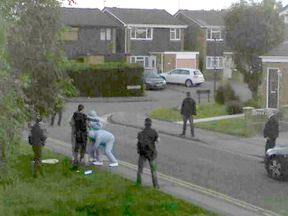 Armed police detain a suspect in Nuneaton, Warwickshire