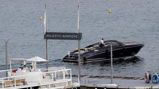 A boat leaves the peer of the Majestic Barriere hotel