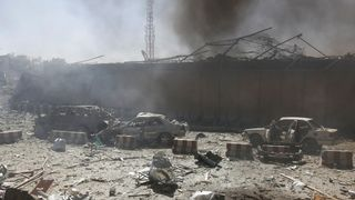 Witnesses said at least 30 cars were destroyed or damaged at the blast site
