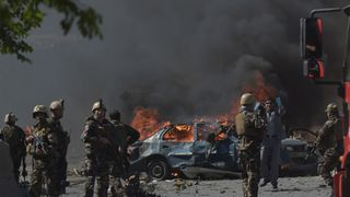 Security forces near the area where the car bomb exploded