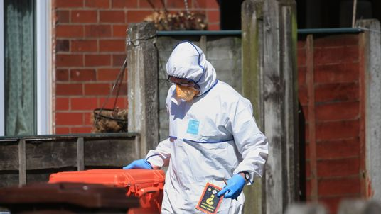 A forensic investigator at a home in Elsmore Road where Salman Abedi was registered as living