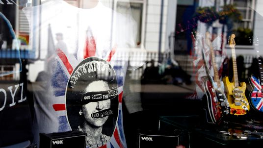 A Sex Pistols' God Save The Queen t-shirt is seen in a shop window on Pembridge road in west London May 27, 2012