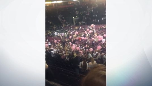 """People fleeing an """"explosion"""" at Manchester Arena. Pic: @HannahWWH"""
