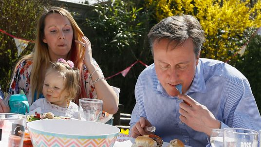 Prime Minister David Cameron speaks with Lilli Docherty and her daughter Dakota, as he has lunch with people who have benefited from tax and pension changes that come into force, in a garden on April 6, 2015 near Poole, England. Britain goes to the polls for a general election on May 7