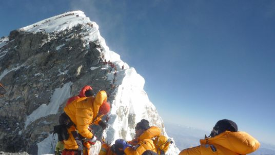 Climbers pause on the Hillary Step before going to the summit of Mount Everest