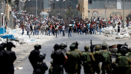 A clash between Israeli troops and Palestinians at a protest in support of the hunger strike