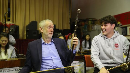Jeremy Corbyn playing an Erhu - sometimes known as a Chinese violin -