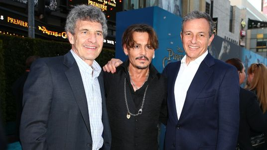 HOLLYWOOD, CA - MAY 18: (L-R) Chairman of Walt Disney Studios Alan Horn, actor Johnny Depp and Chief Executive Officer of Disney Bob Iger attend the premiere of Disney's 'Pirates Of The Caribbean: Dead Men Tell No Tales' at Dolby Theatre on May 18, 2017 in Hollywood, California. (Photo by Rich Fury/Getty Images)