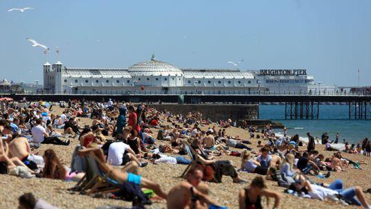 People soak up the sunshine in Brighton