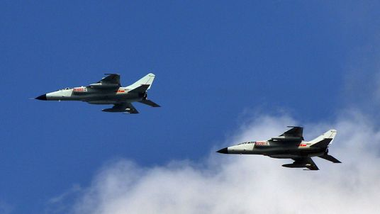 This photo taken on October 23, 2013 shows Chinese People's Liberation Army (PLA) fighter jets leaving their base in Shanghai.