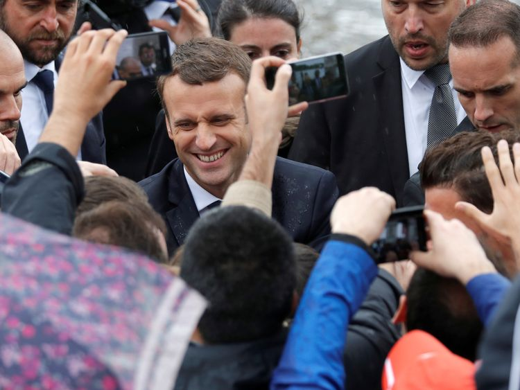 Emmanuel Macron goes on a walkabout after his inauguration