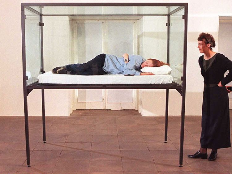 Actress Tilda Swinton sleeps in a glass box as part of an installation conceived by Cornelia Parker