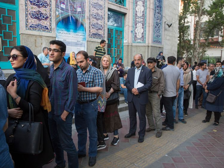 Voters queue in Tehran to vote in the election