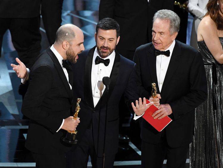 La La Land producer Jordan Horowitz (L) announces actual Best Picture winner as 'Moonlight' after a presentation error