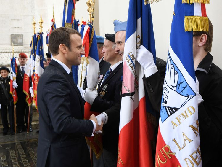 Macron greets veterans after laying a wreath on the unknown Soldier's tomb