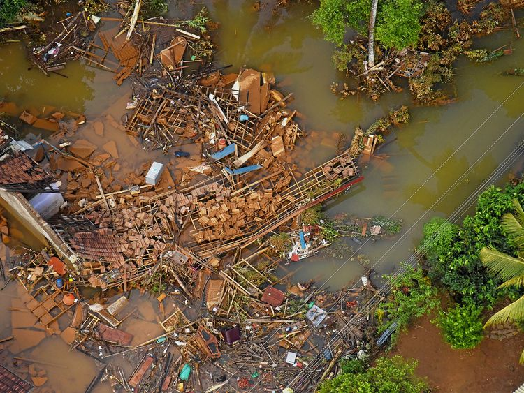 Debris of houses is seen after a flood affected a village in Matara