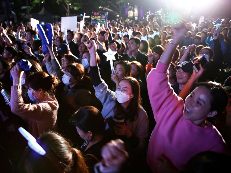 Supporters of South Korea's president-elect Moon Jae-in celebrate at Gwanghwamun Square