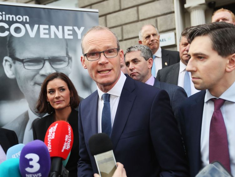 Minister for the Environment and Housing Simon Coveney (centre) alongside Minister for Health Simon Harris (right) outside Fine Gael HQ in Dublin