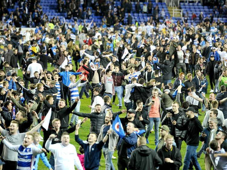 Reading fans celebrate on the pitch after the Sky Bet Championship Play Off Second Leg match against Fulham