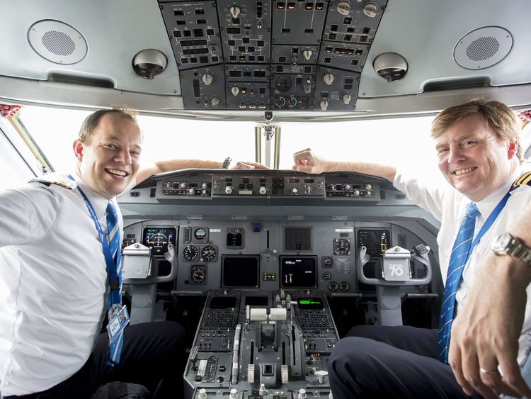 Dutch King Willem-Alexander sitting inside the cockpit of a KLM Cityhopper, next to pilot Maarten Putman, at the Schiphol Airport, near Amsterdam