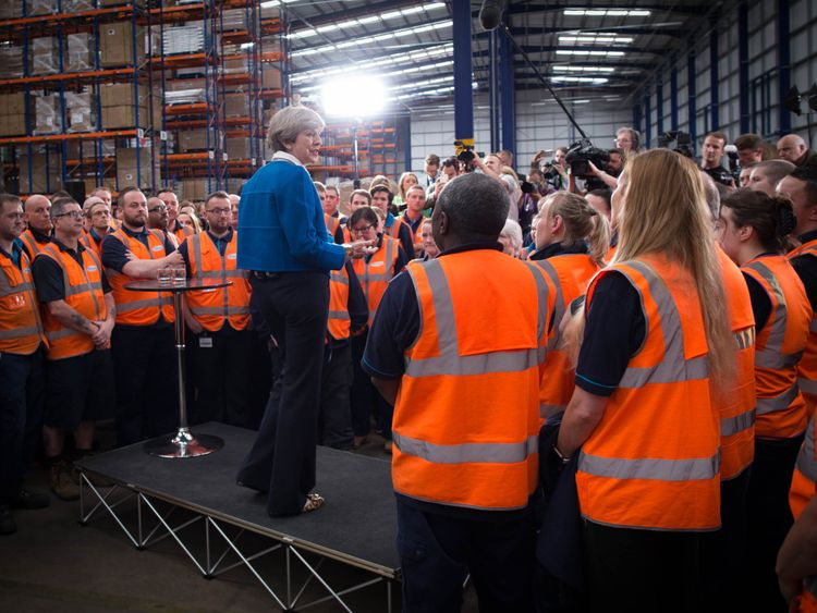 Theresa May fields questions during a visit to a Screwfix factory in Stoke-on-Trent