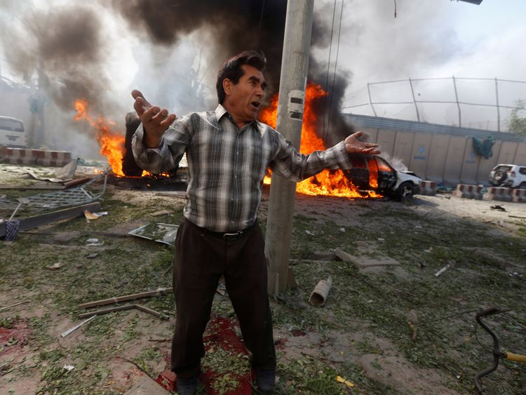 An Afghan man near the site of the car bomb