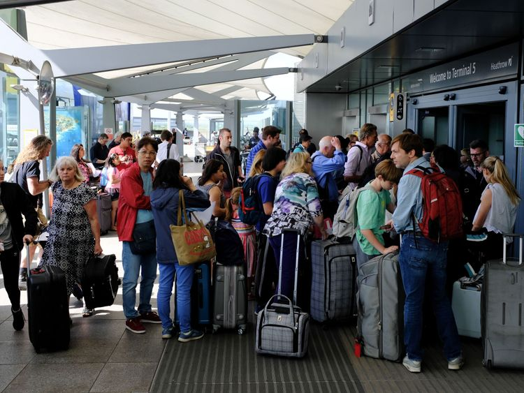 Travellers stranded outside the entrances of Heathrow Airport Terminal 5 after British Airways flights where cancelled are seen at Heathrow Airport in west London on May 27, 2017. British Airways said May 27 that it had cancelled all its flights out of major London airports Heathrow and Gatwick after an IT systems failure, warning people not to travel to the congested hubs. People saying that they are not allowed to enter the terminal