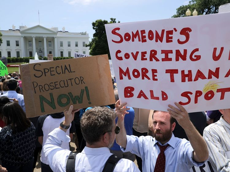 About 300 people rally to protest against President Donald Trump's firing of Federal Bureau of Investigation Director James Comey outside the White House May 10, 2017