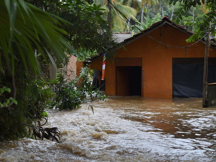 A Sri Lankan home in a suburb of Colombo surrounded by floodwaters