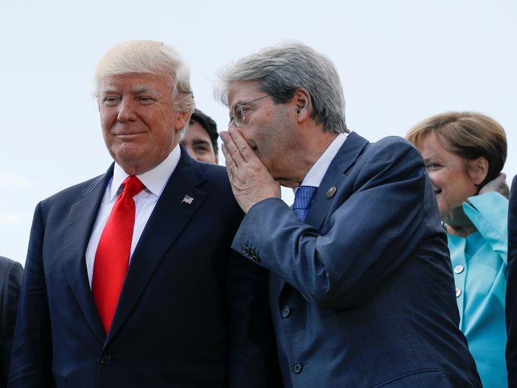 Mr Trump listens to Italian Prime Minister Paolo Gentiloni