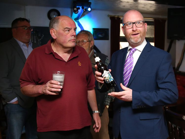 UKIP leader Paul Nuttall enjoying a beer while campaigning, much like his predecessor, Nigel Farage