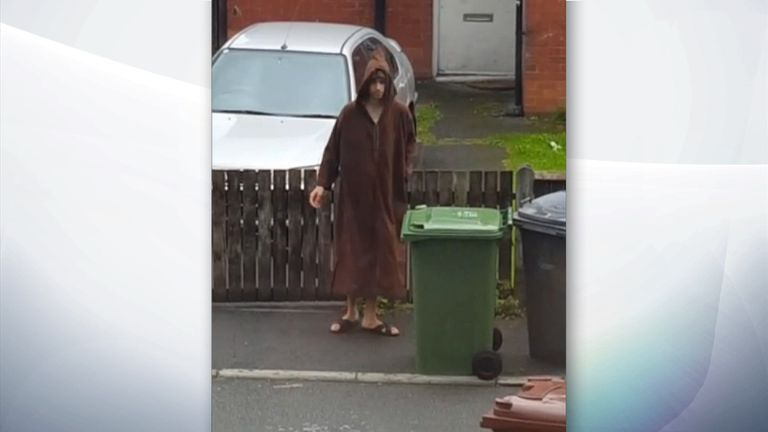 Salman Abedi takes out the bins from his home in Manchester