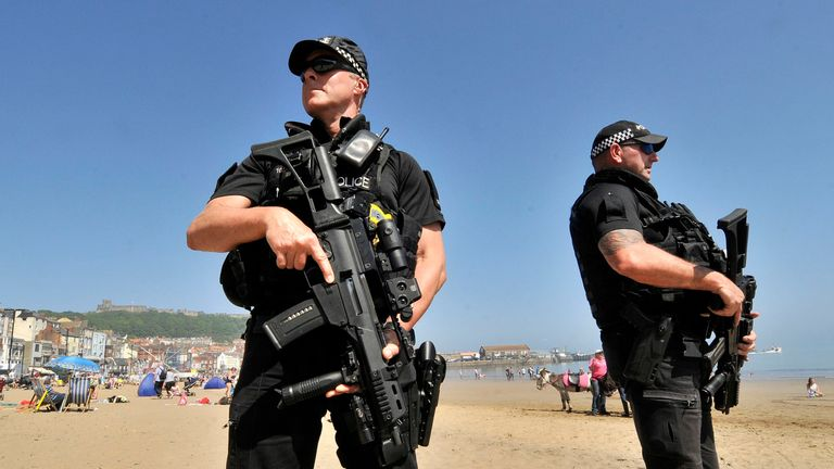 Armed police on patrol at Scarborough beach