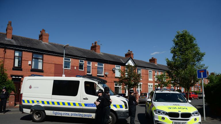 Police raided a residential property in Moss Side, Manchester