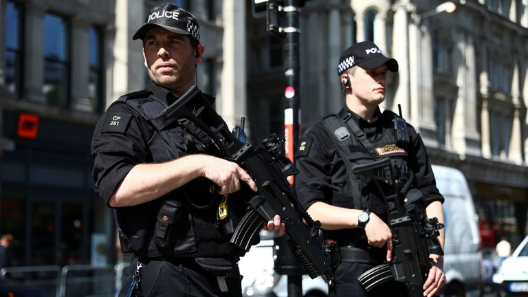 Armed police officers stand on duty outside St Paul's Cathedral in London
