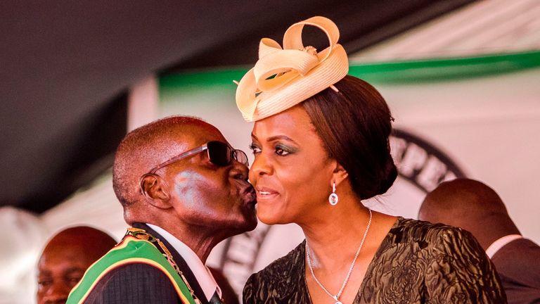 Robert Mugabe kisses his wife Grace in April 2017