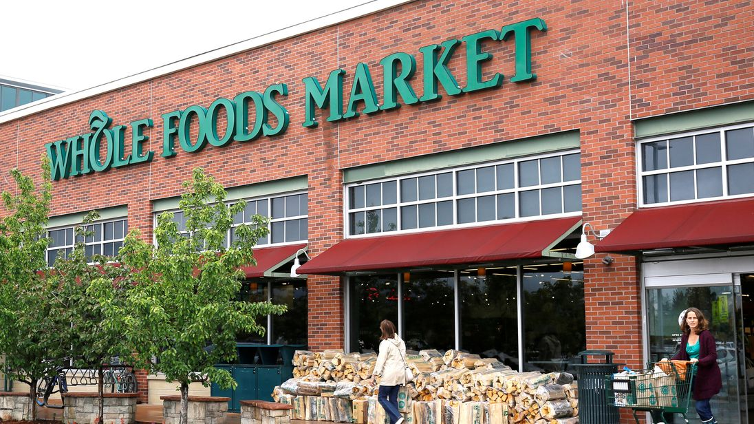 FILE PHOTO - Customers leave the Whole Foods Market in Boulder, Colorado, U.S. on May 10, 2017.