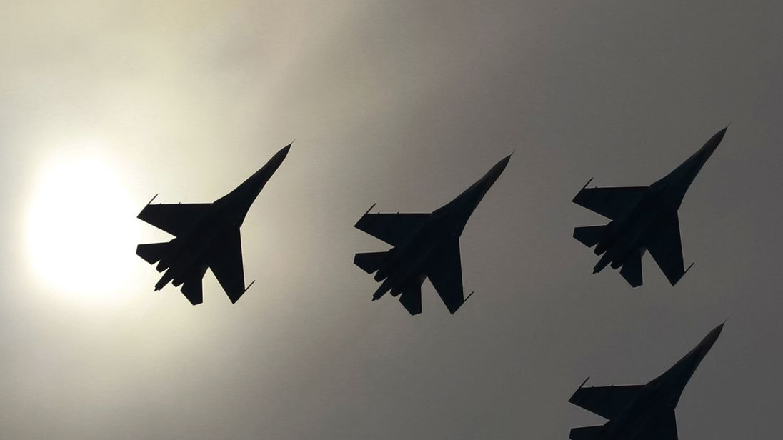 Photos show close encounter between armed Russian jet, US warplane