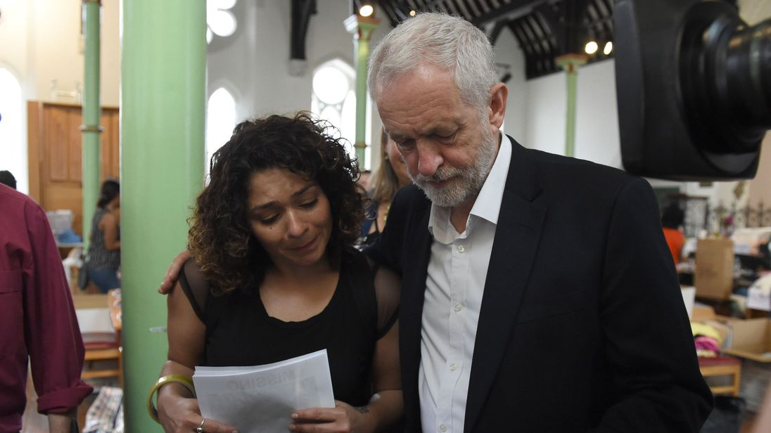 Labour leader Jeremy Corbyn comforts a local resident at St Clement's Church in west London
