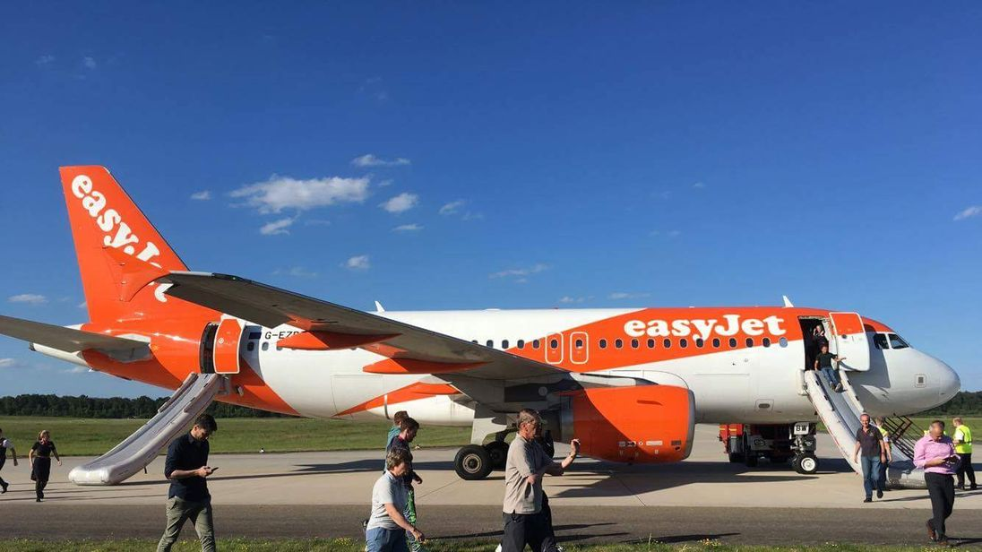 Passengers were rushed off the aircraft using the emergency slides