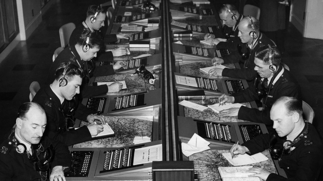 Operators at work dealing with '999' emergency calls in the new Information Room at New Scotland Yard in 1956