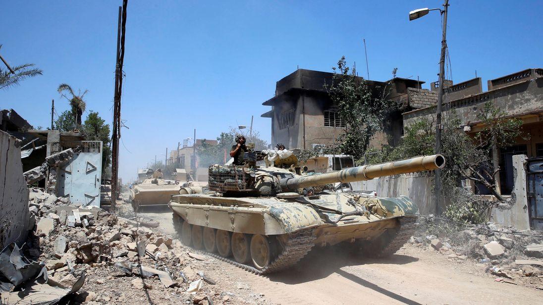 An Iraqi military tanks advances towards Islamic State-held territory in Mosul