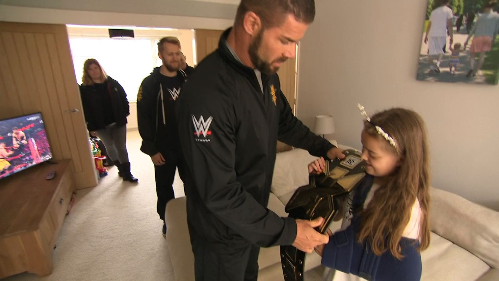 WWE stars make surprise visit to victim of Manchester terror attack